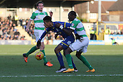 Lyle Taylor of AFC Wimbledon holds the ball up during the Sky Bet League 2 match between AFC Wimbledon and Yeovil Town at the Cherry Red Records Stadium, Kingston, England on 30 January 2016. Photo by Stuart Butcher.