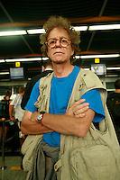 portrait of owen franken in a shooting vest in an airport