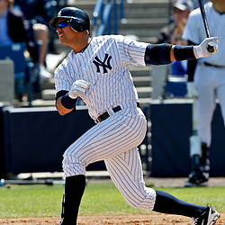March 4, 2012; Tampa Bay, FL, USA; New York Yankees third baseman Alex Rodriguez (13) hits a homerun against the Philadelphia Phillies during spring training game at George M. Steinbrenner Field. Mandatory Credit: Derick E. Hingle-US PRESSWIRE