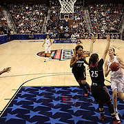 Breanna Stewart, (right), UConn, drives to the basket defended by Chelsea Jamison, Cincinnati, during the UConn Vs Cincinnati Quarterfinal Basketball game at the American Women's College Basketball Championships 2015 at Mohegan Sun Arena, Uncasville, Connecticut, USA. 7th March 2015. Photo Tim Clayton