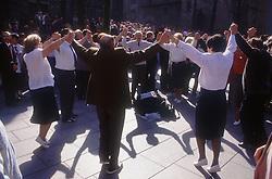 Dancing the Sardana; traditional dance of Catalonia; in Barcelona,