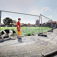 Nederland, Zaandam , 14 juni 2010..Kruispunt bij rosmolenstraat in Rosmolenwijk waar een aantal woningbouwprojecten van corporatie Parteon stil staan.