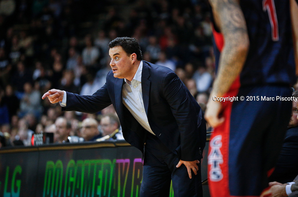 SHOT 2/26/15 9:25:42 PM - Arizona head basketball coach Sean Miller directs the offense as his team play against Colorado during their regular season Pac-12 basketball game at the Coors Events Center in Boulder, Co. Arizona won the game 82-54.<br /> (Photo by Marc Piscotty / &copy; 2015)