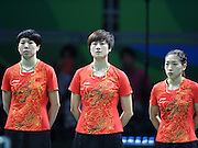 RIO DE JANEIRO, BRAZIL - AUGUST 15: <br /> <br />  Li Xiaoxia, Ding Ning and Liu Shiwen of China attend the Table Tennis Women\'s Team Round Semi Final between China and Singapore during Day 10 of the Rio 2016 Olympic Games at Riocentro - Pavilion 3 on August 15, 2016 in Rio de Janeiro, Brazil.<br /> ©Exclusivepix Media