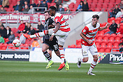 Colchester United midfielder Sammie Szmodics (10)  goes [ast Doncaster Rovers defender Cedric Evina (27)  during the EFL Sky Bet League 2 match between Doncaster Rovers and Colchester United at the Keepmoat Stadium, Doncaster, England on 15 October 2016. Photo by Simon Davies.