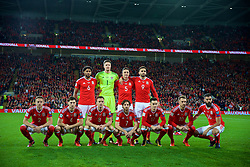 CARDIFF, WALES - Monday, October 9, 2017: Wales' players line-up for a team group photograph before the 2018 FIFA World Cup Qualifying Group D match between Wales and Republic of Ireland at the Cardiff City Stadium. Back row L-R: captain Ashley Williams, goalkeeper Wayne Hennessey, James Chester, Hal Robson-Kanu. Front row L-R: Chris Gunter, Ben Davies, Andy King, Joe Allen, Tom Lawrence, Aaron Ramsey, Joe Ledley. (Pic by David Rawcliffe/Propaganda)