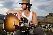"""Alejandro Rose-Garcia of Shakey Graves poses for a portrait backstage at Sasquatch! Music festival on May 24, 2014. Gear: Nikon D750, Nikon 28-70mm Lens, Speedotron Black Line 1205cx, 22"""" Speedotron beauty dish with 30 degree grid for highlight."""