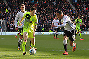 Huddersfield Town midfielder Joe Lolley takes the ball down the wing as defender Marcus Olsson tries to stop the attack during the Sky Bet Championship match between Derby County and Huddersfield Town at the iPro Stadium, Derby, England on 5 March 2016. Photo by Aaron Lupton.