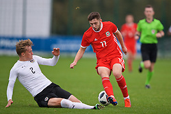 NEWPORT, WALES - Monday, October 14, 2019: Wales' Joe Adams (R) is tackled by Austria's Paul Koller during an Under-19's International Friendly match between Wales and Austria at Dragon Park. (Pic by David Rawcliffe/Propaganda)