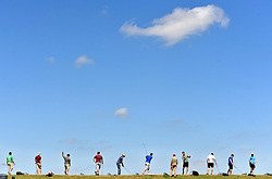 Golfers take aim down range as they swing away at the Texas A&M University Golf Course driving range in College Station, Texas on Tuesday, March 24, 2015.  (AP Photo/The Bryan-College Station Eagle, Sam Craft)