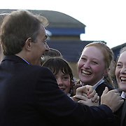 Prime Minister of the United Kingdom Tony Blair greets school kids Friday, November 21, 2003, in Sedgefield, England.  ..Photo by Khue Bui