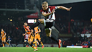 Jake Bidwell with the clerance during the Sky Bet Championship match between Brentford and Hull City at Griffin Park, London, England on 3 November 2015. Photo by Michael Hulf.