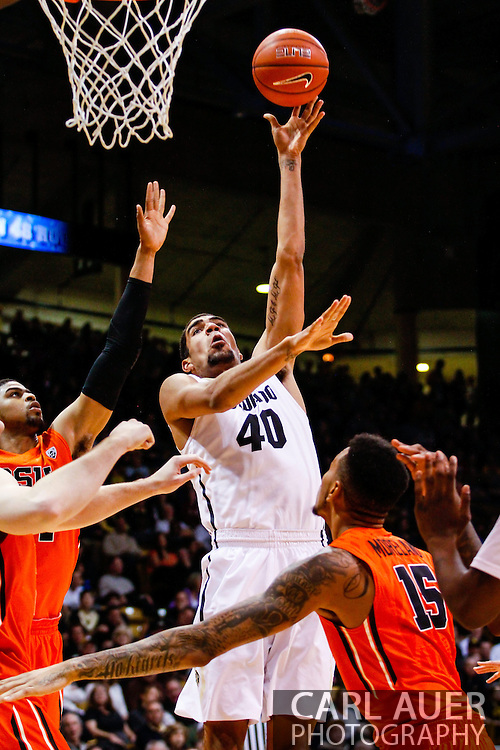 January 2nd, 2014:  Colorado Buffaloes sophomore forward Josh Scott (40) puts up a hook shot in the second half of the NCAA Basketball game between the Oregon State Beavers and the University of Colorado Buffaloes at the Coors Events Center in Boulder, Colorado