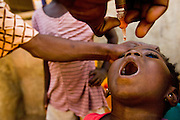 Child receiving oral polio vaccination. Northern Ghana, Thursday November 13, 2008.