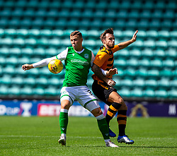 Hibernian's Florian Kamberi and Alloa Athletic's Steven Hetherington. Half time : Hibernian 0 v 0 Alloa Athletic, Betfred Cup game played Saturday 20th July at Easter Road, Edinburgh.