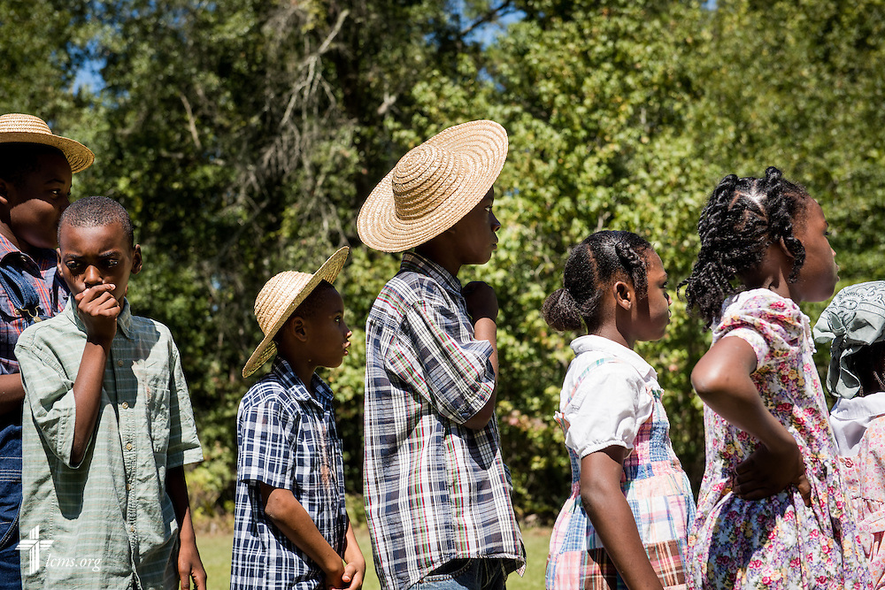 Children dressed in attire reminiscent of the early 20th century queue for lunch during 'The First Rosa' filming on Wednesday, Sept. 24, 2014, at Hope Lutheran Church outside Selma, Ala. LCMS Communications/Erik M. Lunsford