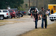 A family leaves the First Baptist Church of Sutherland Springs worship service, the first service since a gunman opened fire inside the small church a week earlier in Sutherland Springs, Texas, U.S. November 12, 2017.  REUTERS/Rick Wilking