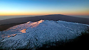 As rays of sunlight bend over the horizon to touch Hawai'i, the snow-laden summit of Mauna Kea is first to feel its warmth.  At 13,796 feet above sea level, it is one of the premier locations in the world for astronomical observation.  Home to many of today's most technologically advanced observatories, the summit's significance was first recognized by the early Hawaiians, utilizing it as a place of worship and study of the heavens… 'O Mauna Kea ko kākou kuahiwi la'a  – Mauna Kea our sacred mountain.