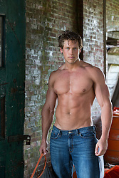 shirtless muscular All American man in an abandoned building