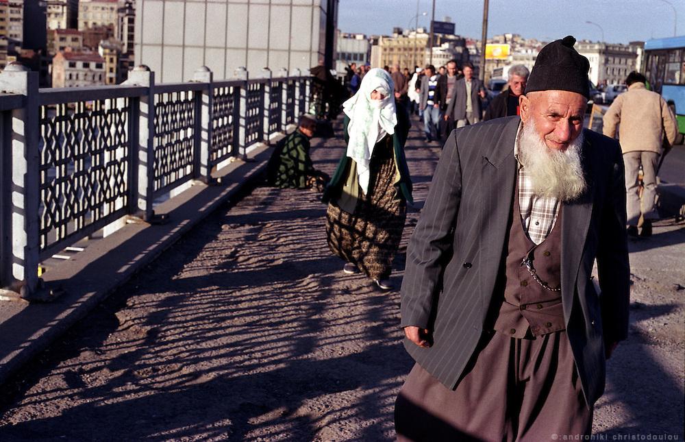 """Traditional"" Muslim couple on Galata bridge..ISTANBUL, Androniki Christodoulou/WorldPictureNews"