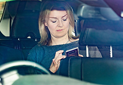 © Licensed to London News Pictures. 01/05/2019. London, UK. Liz Truss, Chief Secretary to the Treasury, holds her phone as she arrives at Parliament for Prime Minister's Questions. Photo credit: Peter Macdiarmid/LNP