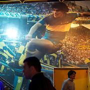 A giant photograph of Diego Maradona playing for Boca Juniors on display in the Museum at Boca Juniors football stadium, La Bombonera, in La Boca region of Buenos Aires, Argentina, 25th June 2010. Photo Tim Clayton..