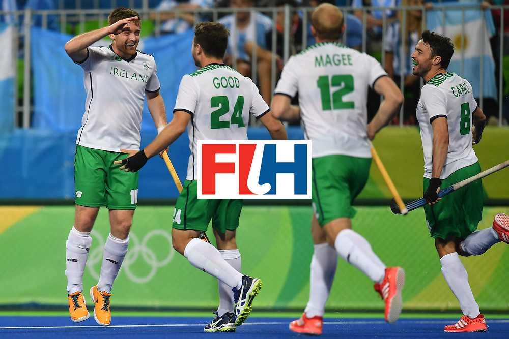 Ireland's Shane O'donoghue (L) celebrates scoring with his teammates during the mens's field hockey Ireland vs Argentina match of the Rio 2016 Olympics Games at the Olympic Hockey Centre in Rio de Janeiro on August, 12 2016. / AFP / MANAN VATSYAYANA        (Photo credit should read MANAN VATSYAYANA/AFP/Getty Images)