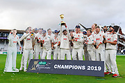 Ryan ten Doeschate of Essex lifts the County Championship trophy with his team during the Specsavers County Champ Div 1 match between Somerset County Cricket Club and Essex County Cricket Club at the Cooper Associates County Ground, Taunton, United Kingdom on 26 September 2019.