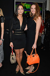 Left to right, ROXIE NAFOUSI and LAUREN REGAN at the Warner Music Group & Belvedere BRIT Awards After Party held at The Savoy, London on 19th February 2014.