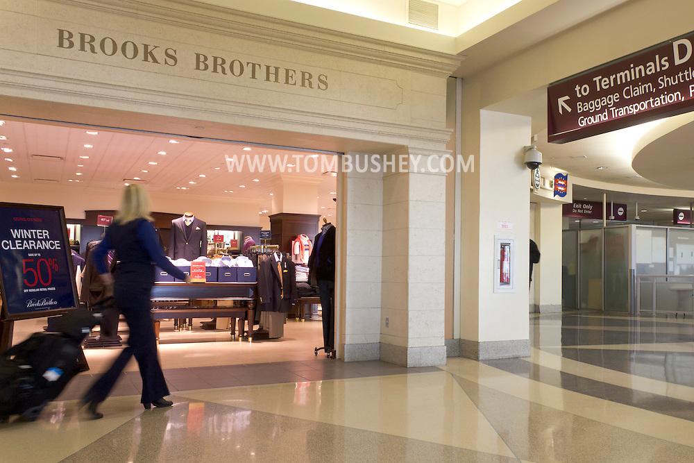Philadelphia, Pennsylvania - A woman walks past a Brooks Brothers store at Philadelphia International Airport on Jan. 26, 2013.