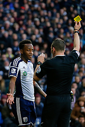 Saido Berahino of West Brom is shown a yellow card by referee Kevin Friend for shouting at the linesman - Photo mandatory by-line: Rogan Thomson/JMP - 07966 386802 - 31/01/2015 - SPORT - FOOTBALL - West Bromwich, England - The Hawthorns - West Bromwich Albion v Tottenham Hotspur - Barclays Premier League.