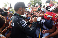 Lewis Hamilton (GBR) Mercedes AMG F1 signs autographs for the fans.<br /> Italian Grand Prix, Sunday 7th September 2014. Monza Italy.