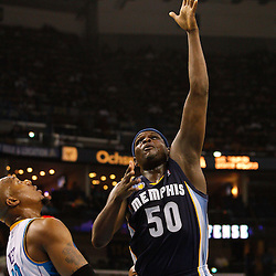 January 19, 2011; New Orleans, LA, USA; Memphis Grizzlies power forward Zach Randolph (50) shoots over New Orleans Hornets power forward David West (30) during the second quarter at the New Orleans Arena.   Mandatory Credit: Derick E. Hingle