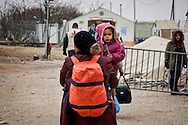 Refugees way to the front door of the Greek-Macedonian border, where they will be transporded by train to the Serbian border. 9 Febraury 2016<br /> Hundreds of refugees arrive at Idomeni and cross the border between Greece and Macedonian on their journey to North Europe.