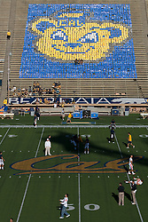 November 7, 2009; Berkeley, CA, USA;  Players from the Oregon State Beavers and the California Golden Bears warm up at midfield before the game at Memorial Stadium.