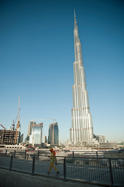 A construction worker in front of the Burj Khalifa inDubai, UAE on February 10, 2010