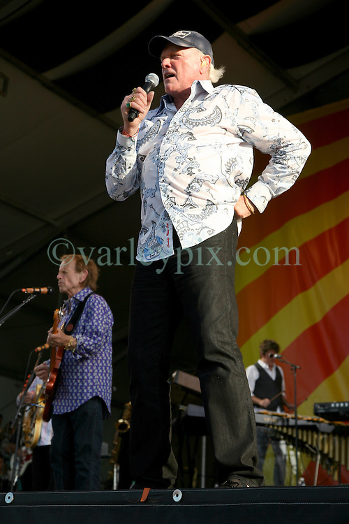 27 April 2012. New Orleans, Louisiana,  USA. .New Orleans Jazz and Heritage Festival. .The Beach Boys take to the stage to kick off their 50th anniversary tour. Mike Love (rt) andAl Jardine on stage..Photo; Charlie Varley.
