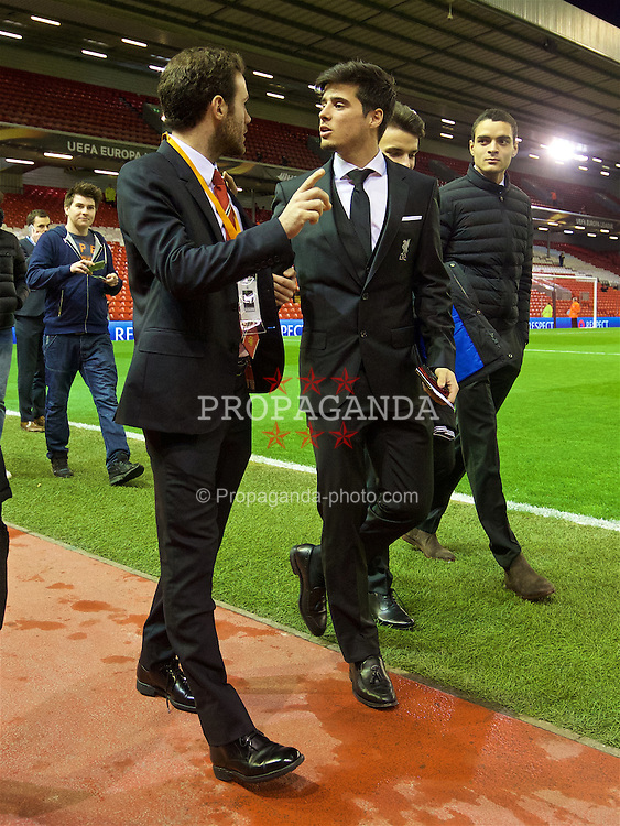 LIVERPOOL, ENGLAND - Thursday, March 10, 2016: Manchester United's Juan Mata and Liverpool's Joao Carlos Teixeira arrive ahead of the UEFA Europa League Round of 16 1st Leg match at Anfield. (Pic by David Rawcliffe/Propaganda)