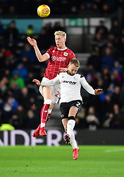 Hordur Magnusson of Bristol City battles for the high ball with  Johnny Russell of Derby County  - Mandatory by-line: Joe Meredith/JMP - 19/01/2018 - FOOTBALL - Pride Park Stadium - Derby, England - Derby County v Bristol City - Sky Bet Championship
