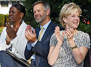 From left, Theresa Jordan, director of the Children's Facility Finance for the Children's Investment Fund, Tom Weber, commissioner of Massachusetts Early Education and Care and Jill Dagilis, executive director of Worcester Community Action Council, applaud Congressman McGovern's announcement of a federal grant for Worcester Community Action Council's Head Start classrooms in Webster, Thursday, Aug. 31, 2017.