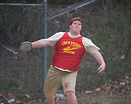 Lafayette High's Jordan Willms throws the discus during the Oxford Eagle Invitational track meet at Oxford High School in Oxford, Miss. on Saturday, March 9, 2013.