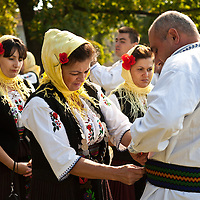 Traditional dancers prepare to perform at the Harvest Festival, Topola, Serbia.