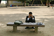 Impromptu desk in a Kobe playground. (Supporting image from the project Hungry Planet: What the World Eats.)
