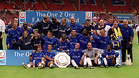 The Chelsea squad celebrates winning the Charity Shield. Chelsea v Manchester United. FA Charity Shield. Wembley 13/8/00. Credit: Colorsport.