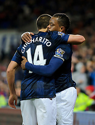 Man Utd Defender Patrice Evra (FRA) celebrates with Forward Javier Hernandez (MEX) after scoring a goal during the first half of the match - Photo mandatory by-line: Rogan Thomson/JMP - Tel: Mobile: 07966 386802 - 24/11/2013 - SPORT - FOOTBALL - Cardiff City Stadium - Cardiff City v Manchester United - Barclays Premier League.