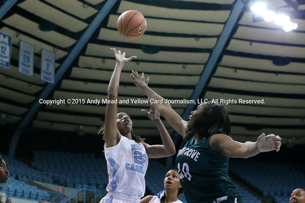 09 November 2015: North Carolina's N'Dea Bryant (22) shoots over Mount Olive's Arieal Johnson (40). The University of North Carolina Tar Heels hosted the University of Mount Olive Trojans at Carmichael Arena in Chapel Hill, North Carolina in a 2015-16 NCAA Women's Basketball exhibition game. UNC won the game 99-45.