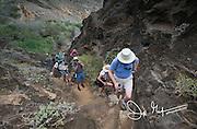 Hikers walk on Punta Pitt at San Cristobal island in the Galapagos archipelago of Ecuador.