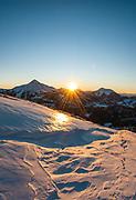 The sun setting between Lone & Fan Peaks.