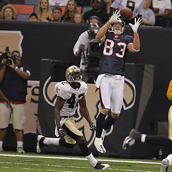 2008 August 16: Houston Texans receiver Kevin Walter (83) catches a 26-yard touchdown pass in front of New Orleans Saints cornerback Jason David (42) during the first quarter of the Saints preseason match up against the Houston Texans at the Louisiana Superdome in New Orleans, LA. .