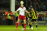 Sheffield United forward Conor Sammon heads the ball during the Sky Bet League 1 match between Burton Albion and Sheffield Utd at the Pirelli Stadium, Burton upon Trent, England on 29 September 2015. Photo by Aaron Lupton.